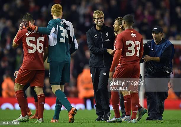 Liverpool's German manager Jurgen Klopp shares a moment with Liverpool's Brazilian midfielder Lucas Leiva and Liverpool's English midfielder Jordon...