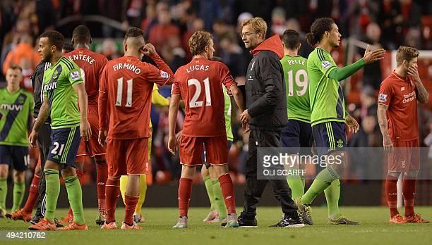 Liverpool's German manager Jurgen Klopp speaks to Liverpool's Brazilian midfielder Lucas Leiva after the English Premier League football match...