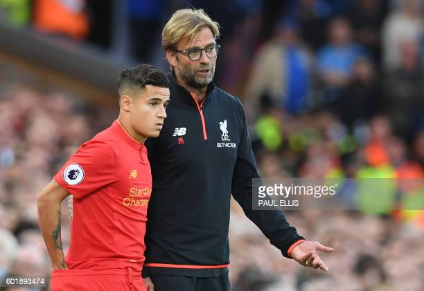 Liverpool's German manager Jurgen Klopp speaks to Liverpool's Brazilian midfielder Philippe Coutinho on the touchline during the English Premier...