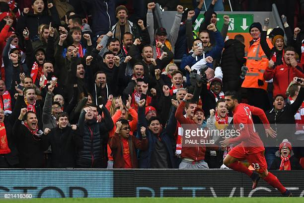 Liverpool's German midfielder Emre Can celebrates scoring his team's third goal during the English Premier League football match between Liverpool...