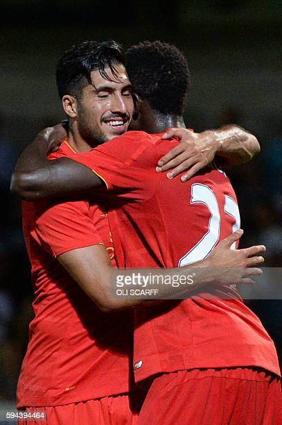 Liverpool's German midfielder Emre Can celebrates with Liverpool's Belgian striker Divock Origi after Burton Albion's English midfielder Tom Naylor...
