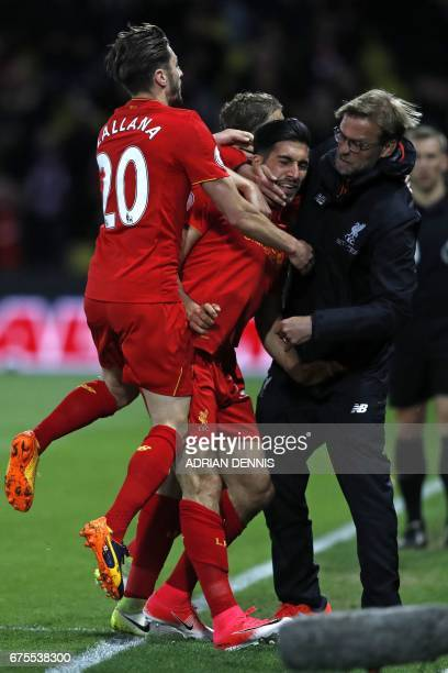 Liverpool's German midfielder Emre Can celebrates with Liverpool's English midfielder Adam Lallana and Liverpool's German manager Jurgen Klopp after...