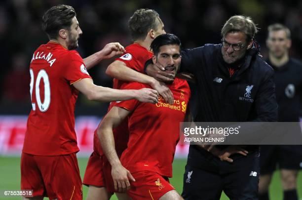 Liverpool's German midfielder Emre Can celebrates with Liverpool's English midfielder Adam Lallana Liverpool's Brazilian midfielder Lucas Leiva and...