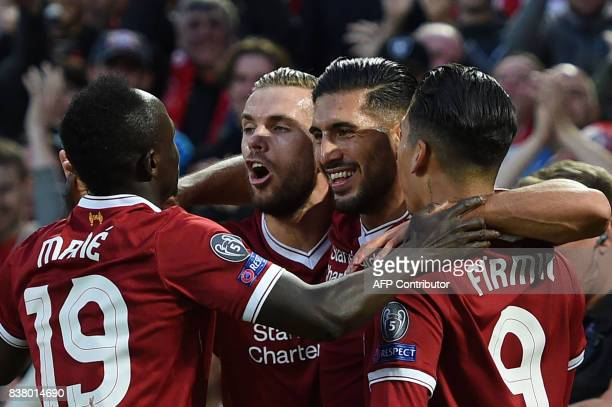 TOPSHOT Liverpool's German midfielder Emre Can celebrates with teammates scoring his team's first goal during the Champions League qualifier second...
