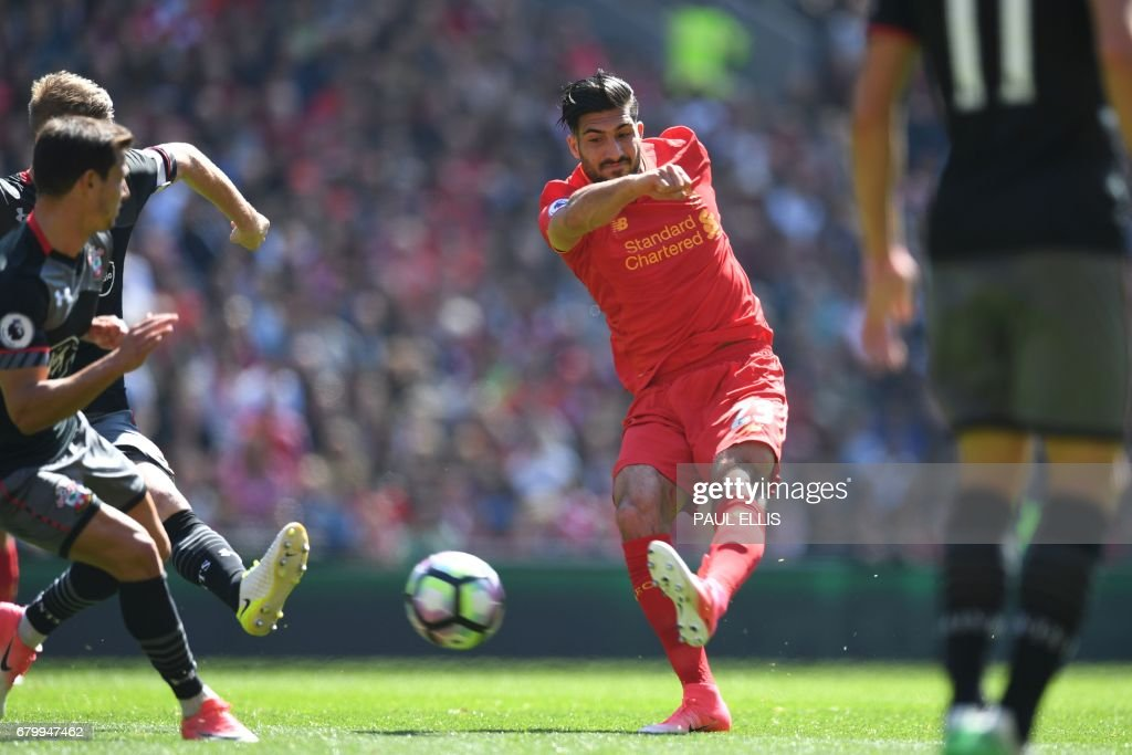 Liverpool's German midfielder Emre Can has a shot on goal during the English Premier League football match between Liverpool and Southampton at Anfield in Liverpool, north west England on May 7, 2017. / AFP PHOTO / Paul ELLIS / RESTRICTED TO EDITORIAL USE. No use with unauthorized audio, video, data, fixture lists, club/league logos or 'live' services. Online in-match use limited to 75 images, no video emulation. No use in betting, games or single club/league/player publications. /