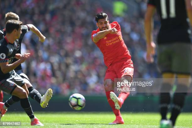 Liverpool's German midfielder Emre Can has a shot on goal during the English Premier League football match between Liverpool and Southampton at...