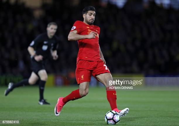 Liverpool's German midfielder Emre Can runs with the ball during the English Premier League football match between Watford and Liverpool at Vicarage...