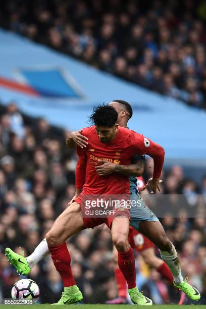 Liverpool's German midfielder Emre Can vies with Manchester City's English midfielder Raheem Sterling during the English Premier League football...