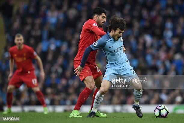 Liverpool's German midfielder Emre Can vies with Manchester City's Spanish midfielder David Silva during the English Premier League football match...