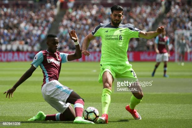 Liverpool's German midfielder Emre Can vies with West Ham United's Swiss midfielder Edimilson Fernandes during the English Premier League football...