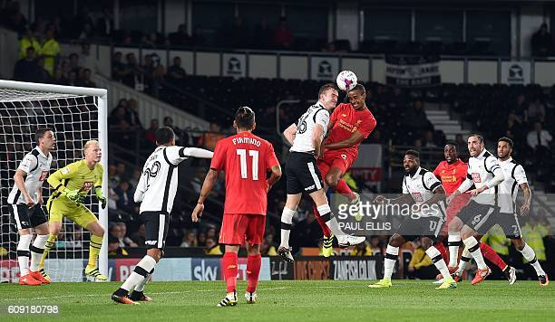 Liverpool's Germanborn Cameroonian defender Joel Matip jumps to head the ball against Derby's Irish defender Alex Pearce during the English League...
