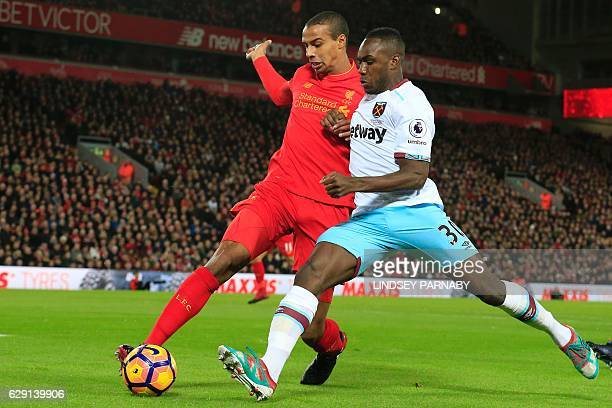Liverpool's Germanborn Cameroonian defender Joel Matip vies with West Ham United's English midfielder Michail Antonio during the English Premier...