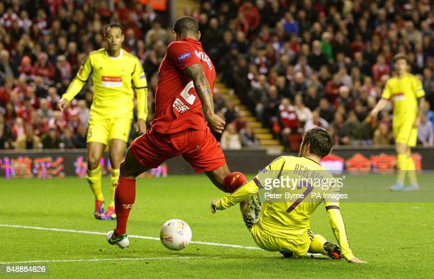 Liverpool's Glen Johnson is challenged by Anzhi Makhachkala's Kamil Agalarov and goes down in the penalty area only for his claims to be waved away...