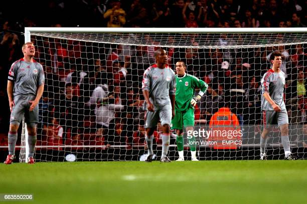 Liverpool's goalkeeper Dean Bouzanis stands dejected after conceding his third goal