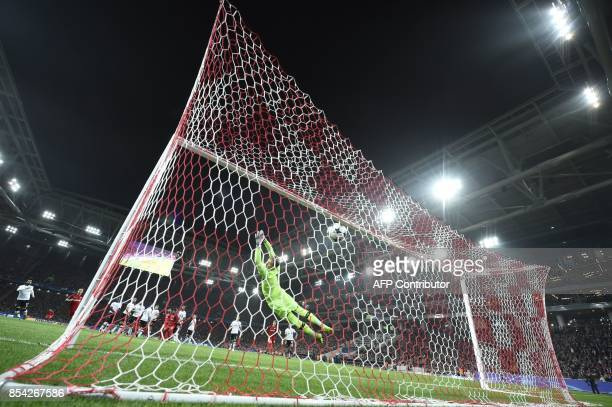 Liverpool's goalkeeper from Germany Loris Karius fails to stop the ball during the UEFA Champions League Group E football match between FC Spartak...