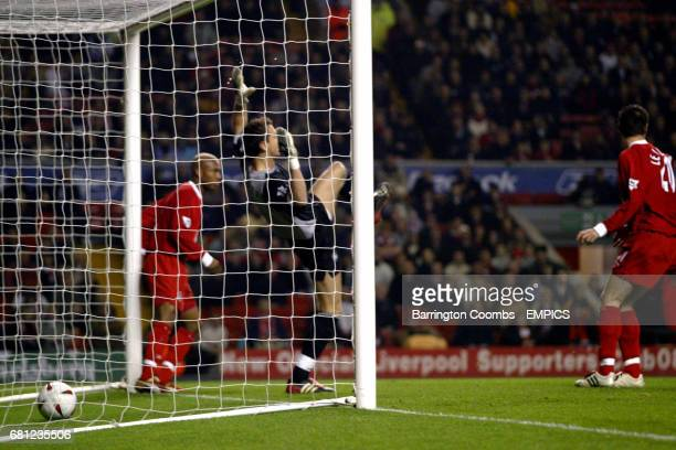 Liverpool's goalkeeper Jerzy Dudek falls backwards as the ball is in the back of the net for the opening goal scored by Bolton Wanderers' Mario Jardel