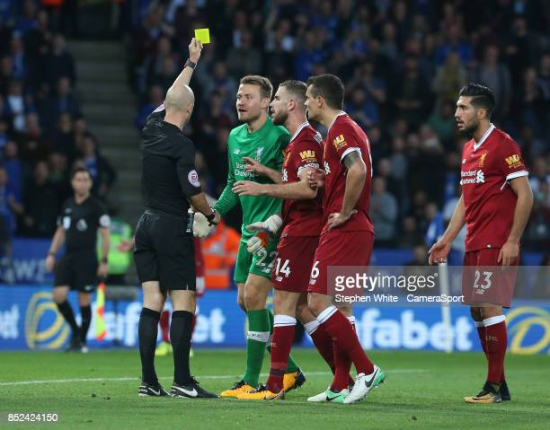 Liverpool's goalkeeper Simon Mignolet reacts to being shown a red card by Referee Anthony Taylor for his foul on Leicester City's Jamie Vardy and...