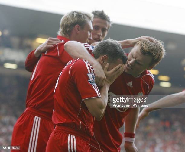 Liverpool's goalscorer Craig Bellamy celebrates with his team mates after scoring the equalizer