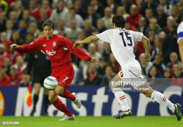 Liverpools Harry Kewell battles with AS Monaco's Andreas Zikos during the UEFA Champions League Group A match at Anfield Liverpool THIS PICTURE CAN...