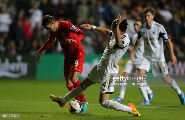 Liverpool's Iago Aspas and Swansea City's Chico battle for the ball