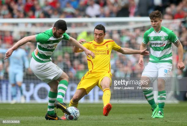 Liverpool's Iago Aspas in action with Shamrock Rovers Ryan Brennan during the Friendly match at the Aviva Stadium Dublin Ireland