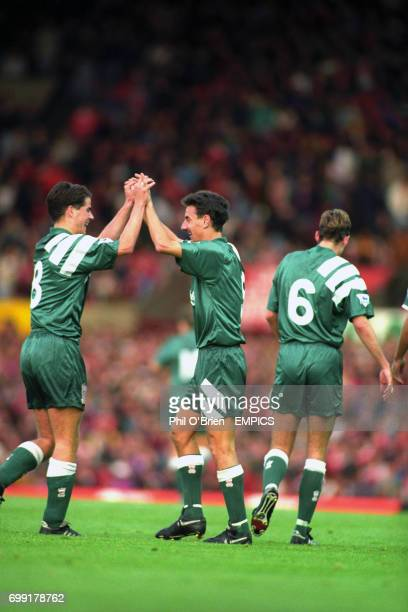 Liverpool's Ian Rush celebrates with Jamie Redknapp after scoring his second goal