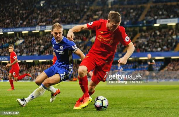 Liverpool's James Milner and Chelsea's Branislav Ivanovic battle for the ball
