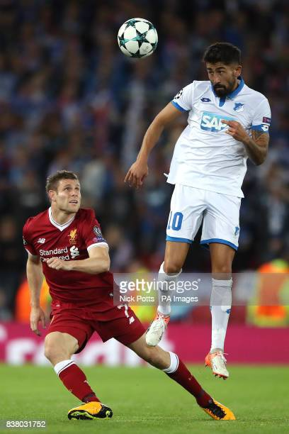Liverpool's James Milner and Hoffenheim's Kerem Demirbay in action during the UEFA Champions League PlayOff Second Leg match at Anfield Liverpool