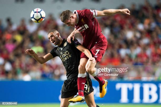 Liverpool's James Milner and Leicester City's Islam Slimani compete for the ball during the final of the Premier League Asia Trophy football...