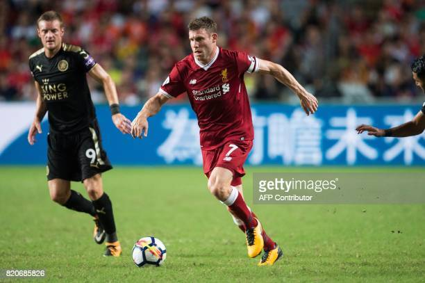 Liverpool's James Milner controls the ball during the final of the Premier League Asia Trophy football tournament between Liverpool and Leicester...