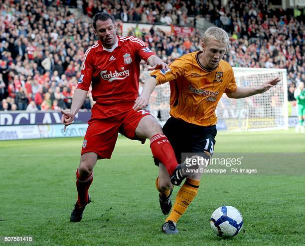 Liverpool's Jamie Carragher and Hull City's Mark Cullen in action