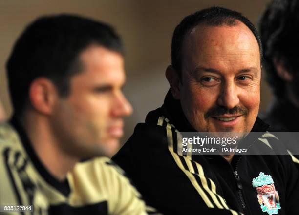 Liverpool's Jamie Carragher and manager Rafael Benitez speak during a press conference at the Santiago Bernabeu Stadium Madrid