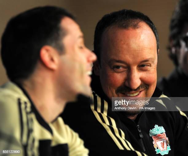 Liverpool's Jamie Carragher and manger Rafael Benitez speak during a press conference at the Santiago Bernabeu Stadium Madrid