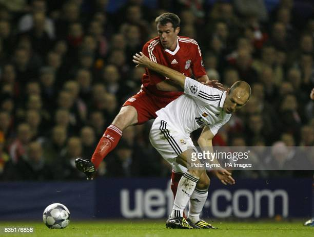 Liverpool's Jamie Carragher and Real Madrid's Arjen Robben battle for the ball