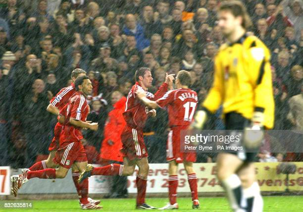 Liverpool's Jamie Carragher celebrates scoring the opening goal with teammates as Fulham goalkeeper Jan Lastuvka stands dejected