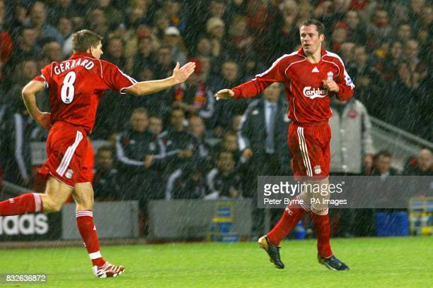 Liverpool's Jamie Carragher celebrates with Steven Gerrard after scoring the second goal