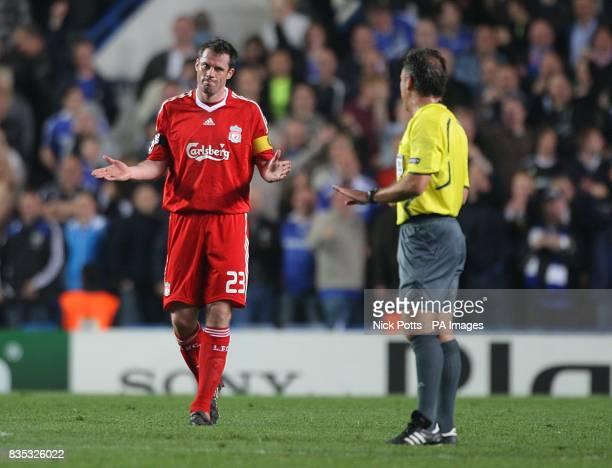 Liverpool's Jamie Carragher gestures towards match referee Luis Medina Cantalejo