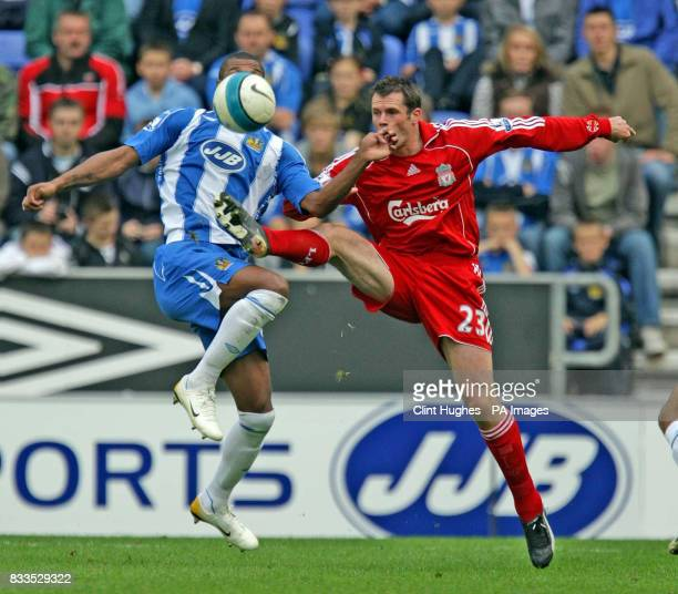 Liverpool's Jamie Carragher gets to the ball ahead of Wigan's Marcus Bent during the Barclays Premier League match at the JJB Stadium Wigan