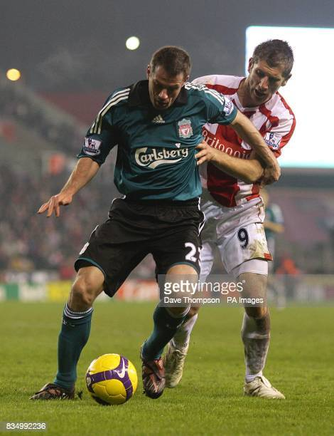 Liverpool's Jamie Carragher holds off a cahllange from Stoke City's Richard Cresswell