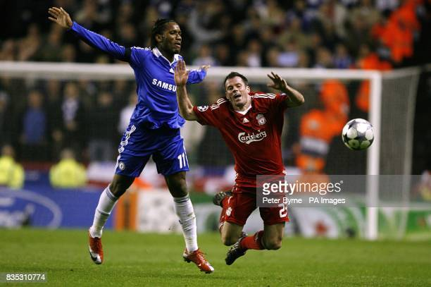 Liverpool's Jamie Carragher is brought down by Chelsea's Didier Drogba
