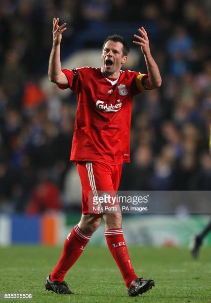Liverpool's Jamie Carragher rallies the crowd as he leaves the field of play at half time