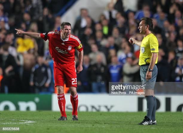 Liverpool's Jamie Carragher shouts towards match referee Luis Medina Cantalejo