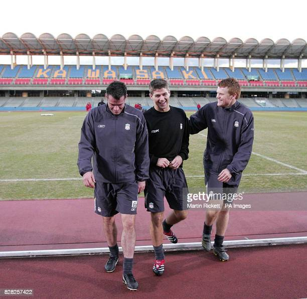 Liverpool's Jamie Carragher Steven Gerrard and John Arne Riise following a training session at the Todoroki Stadium in Kawasaki Japan Monday December...