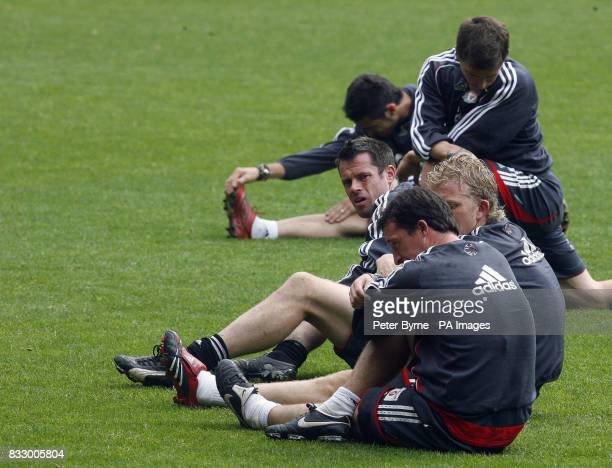 Liverpool's Jamie Carragher with Dirk Kuyt and Robbie Fowler during a training session at Anfield Liverpool