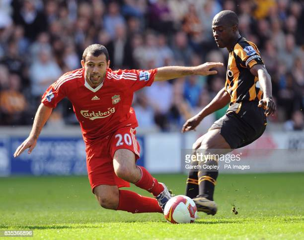 Liverpool's Javier Mascherano and Hull City's George Boateng battle for the ball