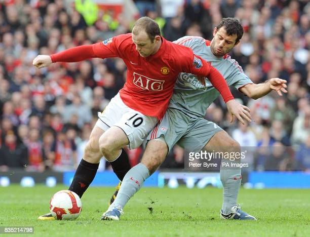 Liverpool's Javier Mascherano and Manchester United's Wayne Rooney battle for the ball