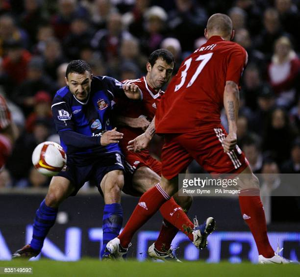 Liverpool's Javier Mascherano and Sunderland's Steed Malbranque battle for the ball as Liverpool's Martin Skrtel looks on