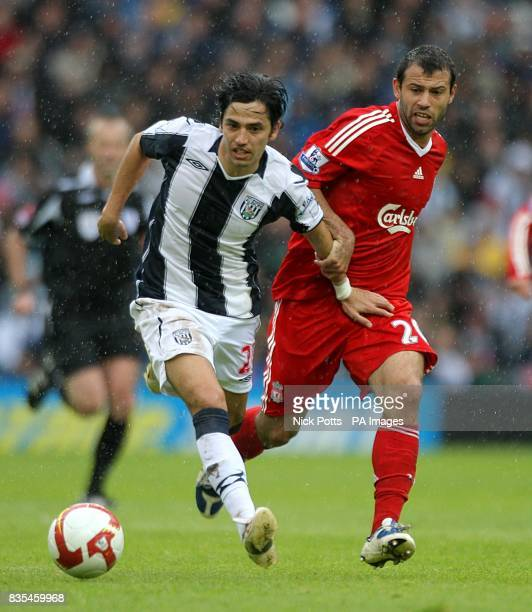 Liverpool's Javier Mascherano and West Bromwich Albion's Juan Carlos Menseguez battle for the ball