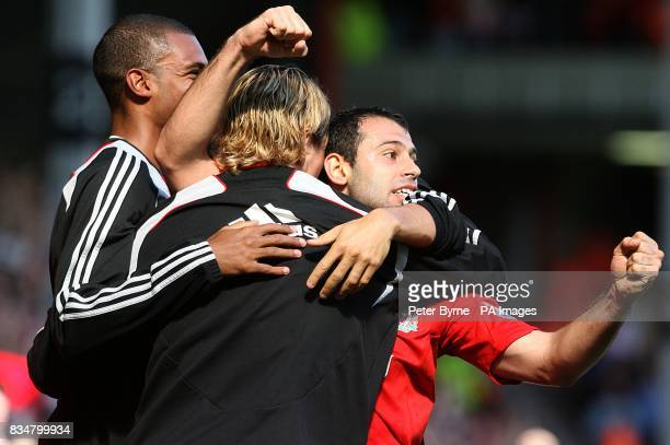 Liverpool's Javier Mascherano celebrates after team mate Ryan Babel scores the third goal of the game