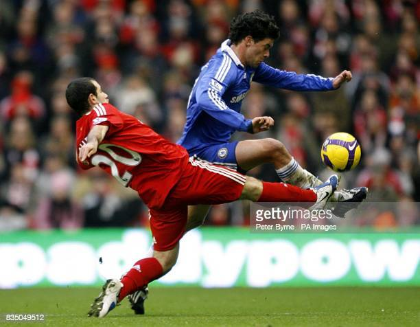 Liverpool's Javier Mascherano challenges Chelsea's Michael Ballack for the ball